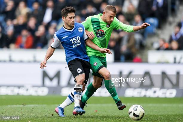 Michael Goerlitz of Bielefeld and Nicky Adler of Aue battle for the ball during the Second Bundesliga match between DSC Arminia Bielefeld and FC...