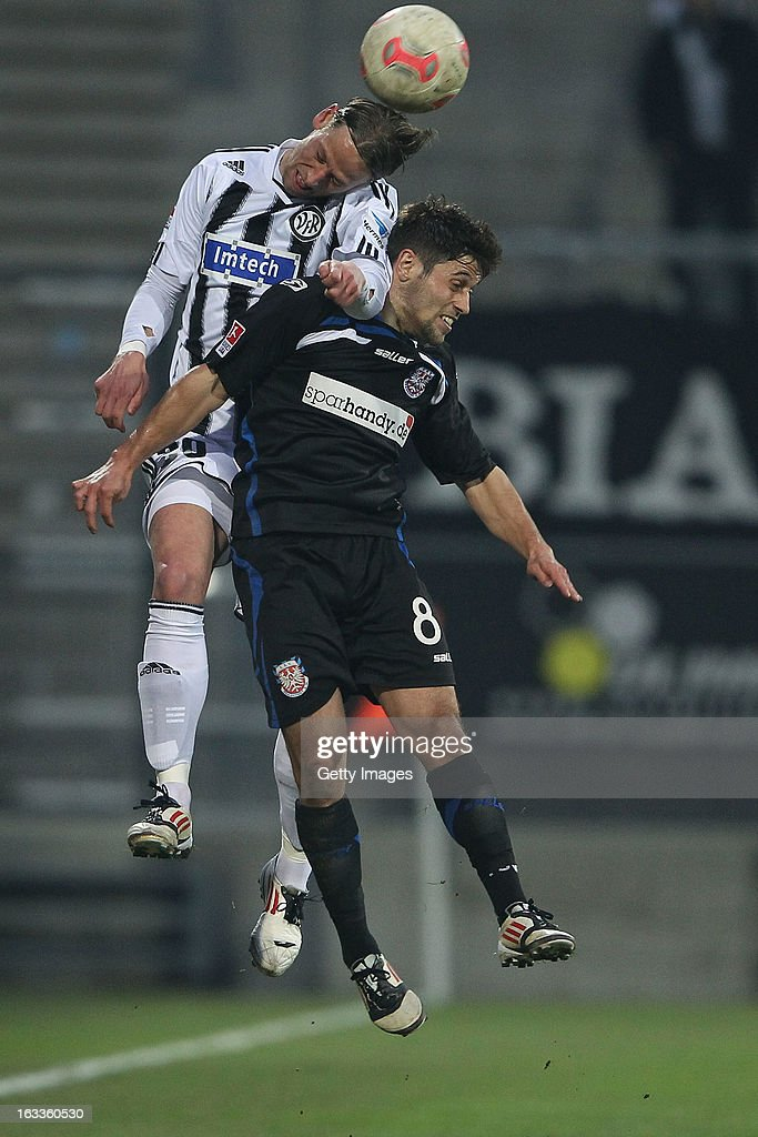Michael Goerlitz of Frankfurt (R) jumps for a header with Marcel Reichwein (L) during the Second Bundesliga match between FSV Frankfurt and VfR Aalen at Frankfurter Volksbank Stadium on March 8, 2013 in Frankfurt am Main, Germany.