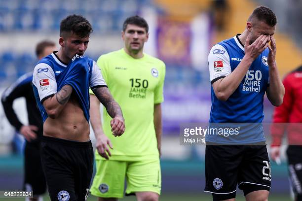 Michael Goerlitz Wolfgang Hesl and Florian Hartherz of Bielefeld react after the Second Bundesliga match between DSC Arminia Bielefeld and FC...