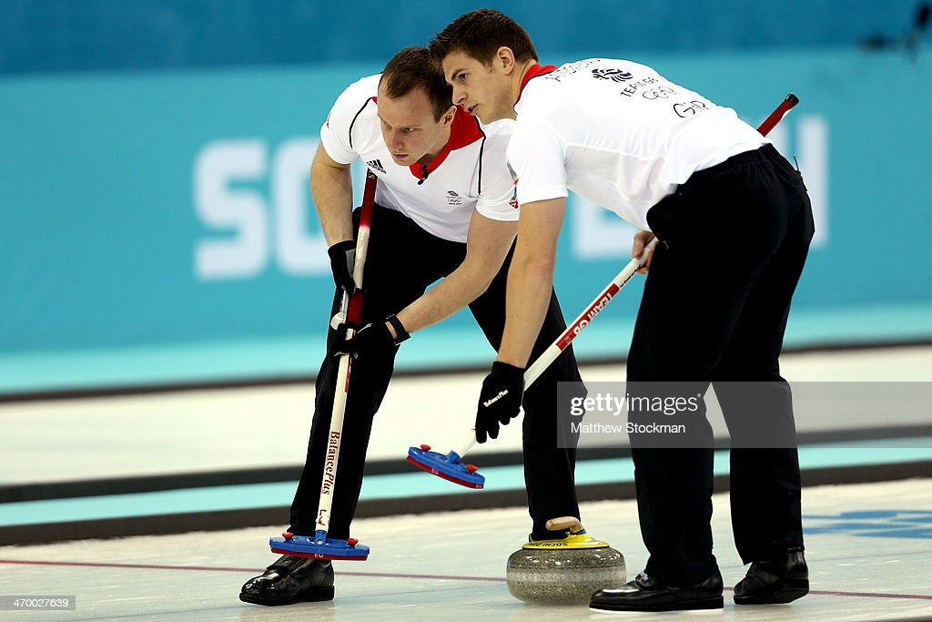 Michael Goodfellow and Scott Andrews of Great Britain sweep the ice while playing Norway during the Curling at Ice Cube Curling Center on day 11 of the 2014 Sochi Winter Olympics on February 18, 2014 in Sochi, Russia.