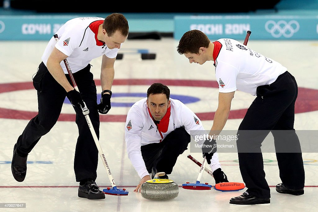 Michael Goodfellow and Scott Andrews of Great Britain sweep the ice in front of <a gi-track='captionPersonalityLinkClicked' href=/galleries/search?phrase=David+Murdoch&family=editorial&specificpeople=722405 ng-click='$event.stopPropagation()'>David Murdoch</a> while playing Norway during the Curling at Ice Cube Curling Center on day 11 of the 2014 Sochi Winter Olympics on February 18, 2014 in Sochi, Russia.