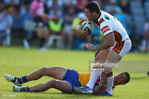 Michael Gordon of Country is tackled during the Origin match between City and Country at BCU International Stadium on April 21 2013 in Coffs Harbour...