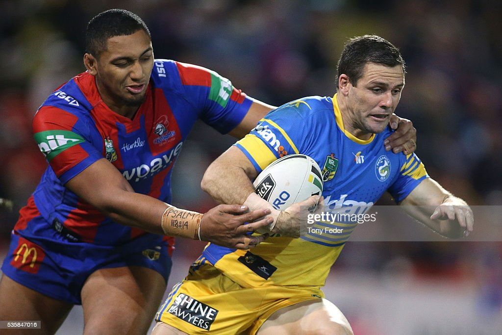 <a gi-track='captionPersonalityLinkClicked' href=/galleries/search?phrase=Michael+Gordon+-+Rugbyspieler&family=editorial&specificpeople=4700592 ng-click='$event.stopPropagation()'>Michael Gordon</a> of the Eels is tackled by Pauli Pauli of the Knights during the round 12 NRL match between the Newcastle Knights and the Parramatta Eels at Hunter Stadium on May 30, 2016 in Newcastle, Australia.