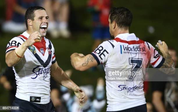 Michael Gordon of the Roosters celebrates scoring a try with team mate Mitchell Pearce during the round three NRL match between the Penrith Panthers...