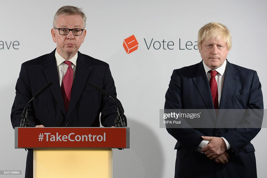 Michael Gove MP speaks during a press conference as Boris Johnson MP looks on following the results of the EU referendum at Westminster Tower on June...