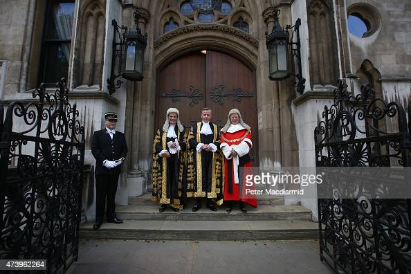 Michael Gove stands with Master of the Rolls Lord Dyson and The Lord Chief Justice Baron Thomas of Cwmgiedd as he arrives at The Royal Courts of...