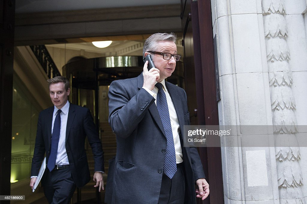 Michael Gove (R), the former Education Secretary, leaves a television studio in Westminster on July 15, 2014 in London, England. British Prime Minister David Cameron is conducting a reshuffle of his Cabinet team with a greater number of women expected to be appointed to senior positions.