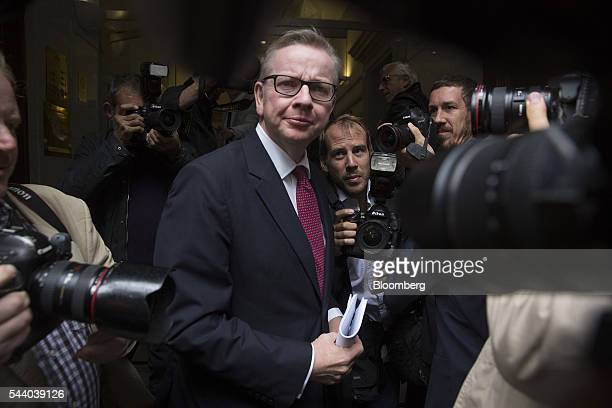 Michael Gove UK justice secretary center stands surrounded by photographers as he arrives for a news conference to announce his Conservative party...
