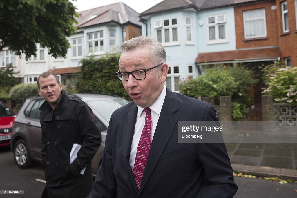 Michael Gove, U.K. justice secretary, right, looks on as he leaves his home in London, U.K., on Friday, July 1, 2016. Hours after his announcement, Gove used a BBC interview to skewer Boris Johnson for his inability to build a team and portray himself as the conviction politician the country needs to negotiate a Brexit. Photographer: Simon Dawson/Bloomberg via Getty Images