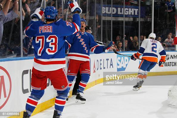 Michael Grabner and Brandon Pirri of the New York Rangers celebrate after scoring a goal in the first period against the New York Islanders at...