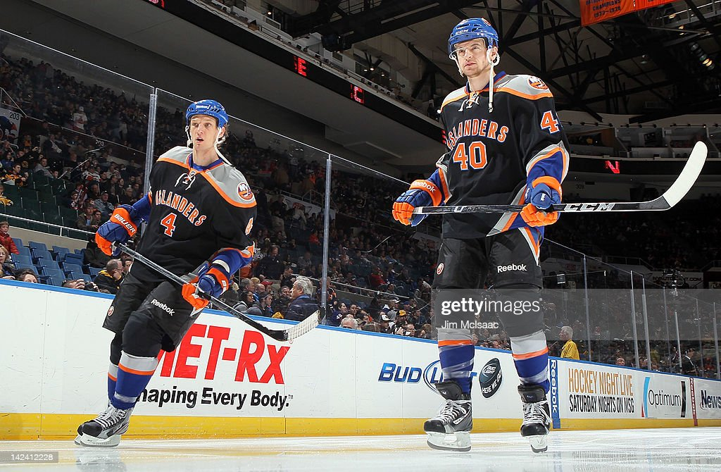 Michael Grabner #40 and Mark Eaton #4 of the New York Islanders prepare to play against the Boston Bruins on March 31, 2012 at Nassau Coliseum in Uniondale, New York.