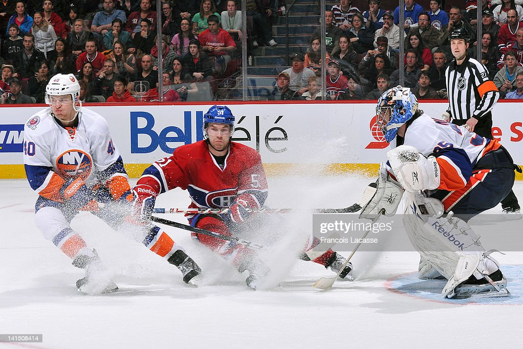<a gi-track='captionPersonalityLinkClicked' href=/galleries/search?phrase=Michael+Grabner&family=editorial&specificpeople=537955 ng-click='$event.stopPropagation()'>Michael Grabner</a> #40 of the New York Islanders and David Desharnais #51 of the Montreal Canadiens make a sudden stop in front of goalie <a gi-track='captionPersonalityLinkClicked' href=/galleries/search?phrase=Al+Montoya&family=editorial&specificpeople=213916 ng-click='$event.stopPropagation()'>Al Montoya</a> #35 during the NHL game on March 17, 2012 at the Bell Centre in Montreal, Quebec, Canada.