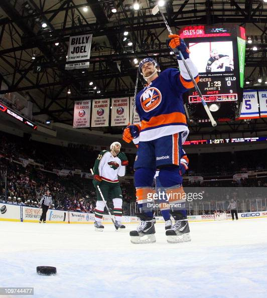Michael Grabner of the New York Islanders celebrates a goal against the Minnesota Wild at the Nassau Coliseum on March 2 2011 in Uniondale New York...