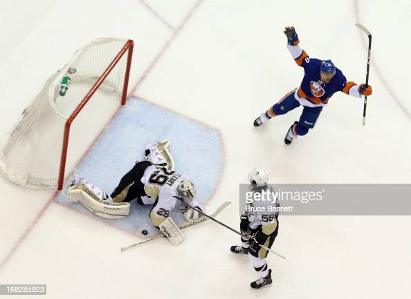 Michael Grabner of the New York Islanders celebrates an Islander goal against MarcAndre Fleury of the Pittsburgh Penguins in Game Four of the Eastern...