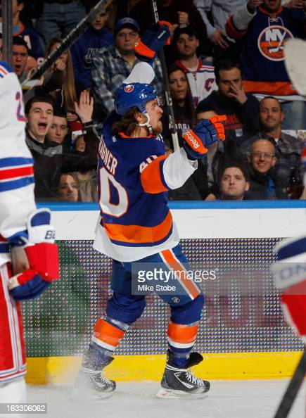 Michael Grabner of the New York Islanders celebrates his first period goal against the New York Rangers at Nassau Veterans Memorial Coliseum on March...
