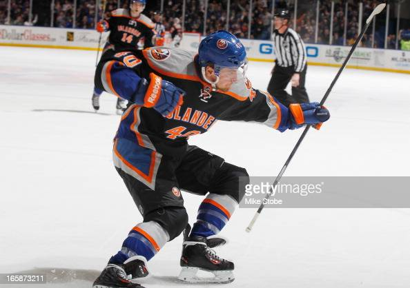 Michael Grabner of the New York Islanders celebrates his first period goal during the game against the Tampa Bay Lightning at Nassau Veterans...