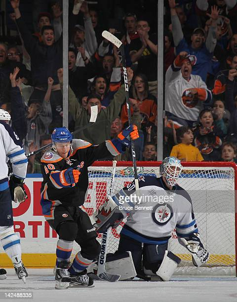 Michael Grabner of the New York Islanders celebrates his game winning goal at 1913 of the third period against Chris Mason of the Winnipeg Jets at...