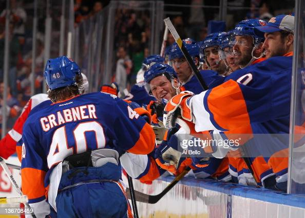 Michael Grabner of the New York Islanders celebrates his goal against the Detroit Red Wings with teammates during their game on January10 2012 at the...