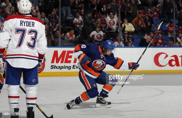 Michael Grabner of the New York Islanders celebrates his goal against the Montreal Canadiens at 1258 of the second period at the Nassau Veterans...