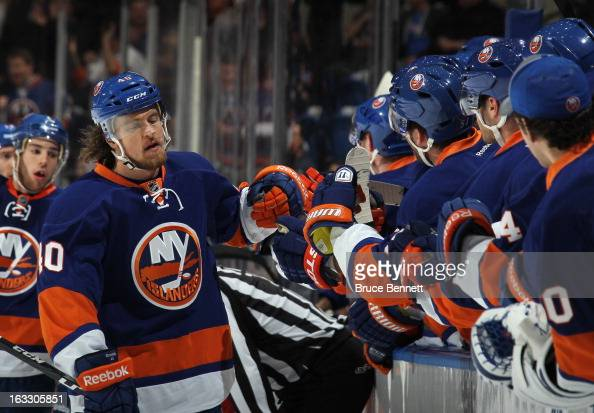 Michael Grabner of the New York Islanders celebrates his goal at 1151 of the first period against the New York Rangers at the Nassau Veterans...