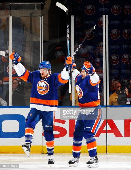 Michael Grabner of the New York Islanders celebrates his second period goal with teammate Radek Martinek in a game against the Columbus Blue Jackets...