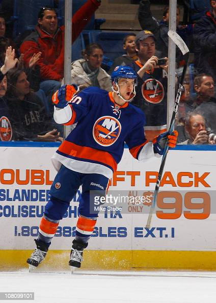 Michael Grabner of the New York Islanders celebrates his second period goal against the New Jersey Devils on January 17 2011 at Nassau Coliseum in...