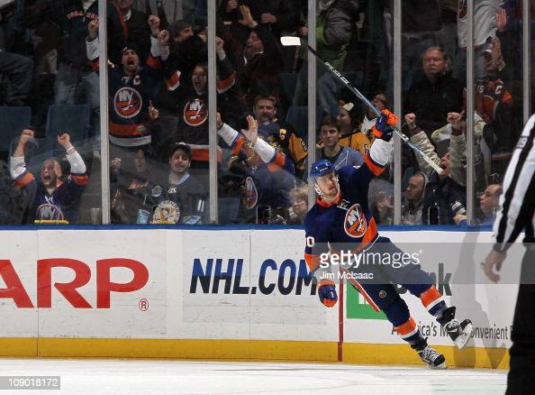 Michael Grabner of the New York Islanders celebrates his second goal against the Pittsburgh Penguins on February 11 2011 at Nassau Coliseum in...