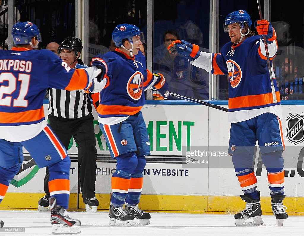 Michael Grabner #40 of the New York Islanders celebrates his second period goal with teammates Kyle Okposo #21 and Keith Aucoin #10 during the game against the Tampa Bay Lightning at Nassau Veterans Memorial Coliseum on January 21, 2013 in Uniondale, New York.