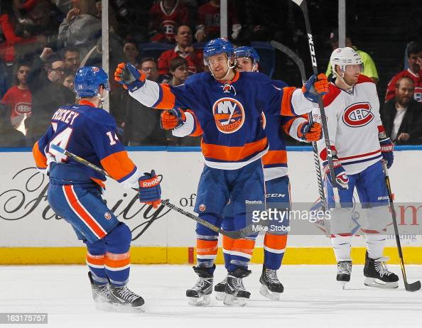 Michael Grabner of the New York Islanders celebrates his second period goal against the Montreal Canadiens with his teammates at Nassau Veterans...