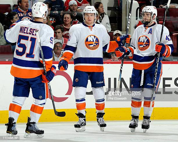 Michael Grabner of the New York Islanders celebrates his secondperiod goal against the Carolina Hurricanes with teammates Frans Nielsen and Andrew...