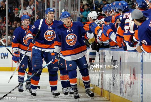 Michael Grabner of the New York Islanders celebrates his third period goal against the Colorado Avalanche on October 16 2010 at Nassau Coliseum in...