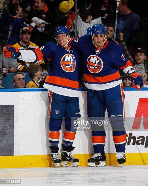 Michael Grabner of the New York Islanders celebrates his third period goal with teammate Milan Jurcina in a game against the Boston Bruins on March...