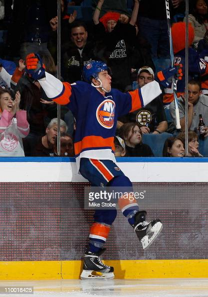 Michael Grabner of the New York Islanders celebrates his third period goal in a game against the Boston Bruins on March 11 2011 at Nassau Coliseum in...