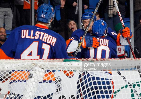 Michael Grabner of the New York Islanders celebrates with his teamates after scoring a 3rd period goal against the New Jersey Devils at Nassau...