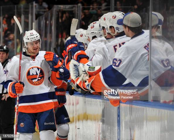 Michael Grabner of the New York Islanders is congratulated after scoring what would be the game winning goal during the third period against the...