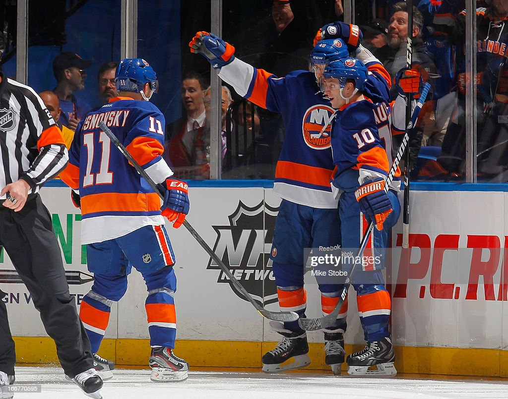 Michael Grabner #40 of the New York Islanders is congratulated by teammates Lubomir Visnovsky #11 and Keith Aucoin #10 on his second goal during the game against the Florida Panthers at Nassau Veterans Memorial Coliseum on April 16, 2013 in Uniondale, New York.