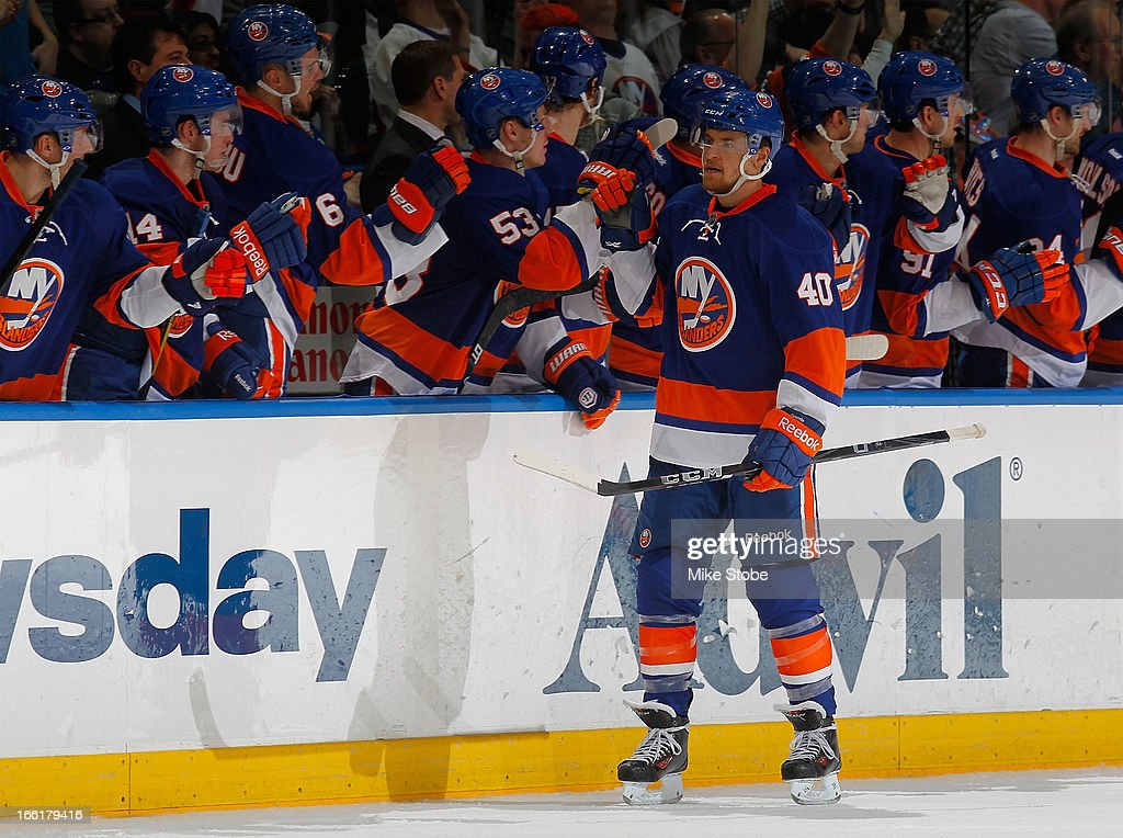 Michael Grabner #40 of the New York Islanders is congratulated by teammates on his second period goal during the game against the Philadelphia Flyers at Nassau Veterans Memorial Coliseum on April 9, 2013 in Uniondale, New York.
