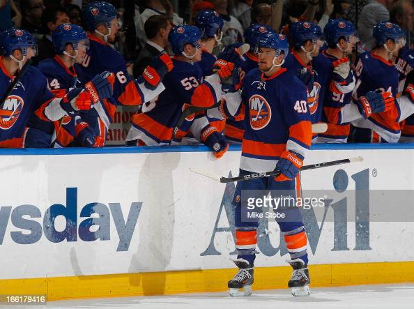 Michael Grabner of the New York Islanders is congratulated by teammates on his second period goal during the game against the Philadelphia Flyers at...