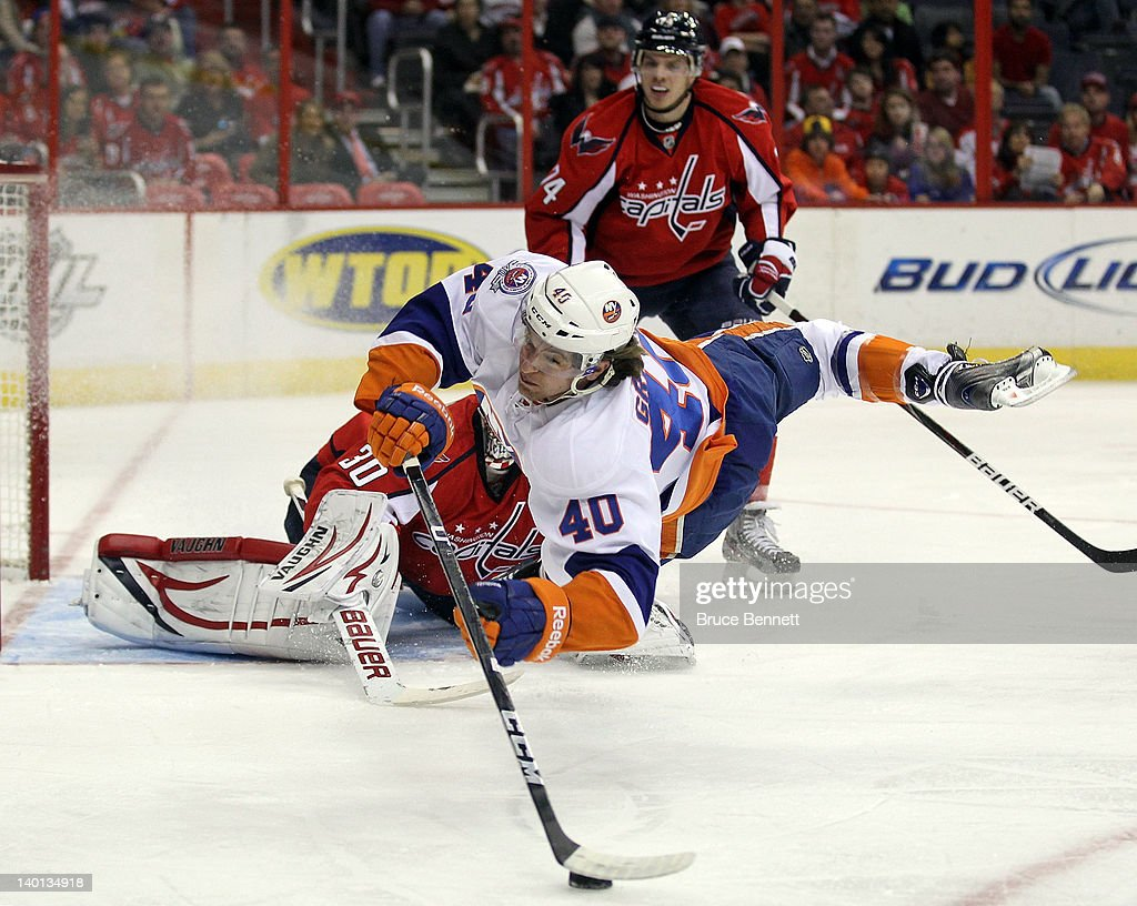 <a gi-track='captionPersonalityLinkClicked' href=/galleries/search?phrase=Michael+Grabner&family=editorial&specificpeople=537955 ng-click='$event.stopPropagation()'>Michael Grabner</a> #40 of the New York Islanders is stopped in his scoring attempt against <a gi-track='captionPersonalityLinkClicked' href=/galleries/search?phrase=Michal+Neuvirth&family=editorial&specificpeople=3205600 ng-click='$event.stopPropagation()'>Michal Neuvirth</a> #30 of the Washington Capitals at the Verizon Center on February 28, 2012 in Washington, DC.