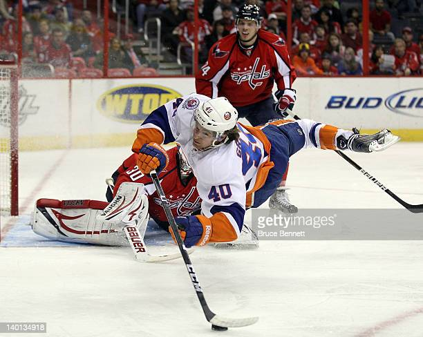 Michael Grabner of the New York Islanders is stopped in his scoring attempt against Michal Neuvirth of the Washington Capitals at the Verizon Center...