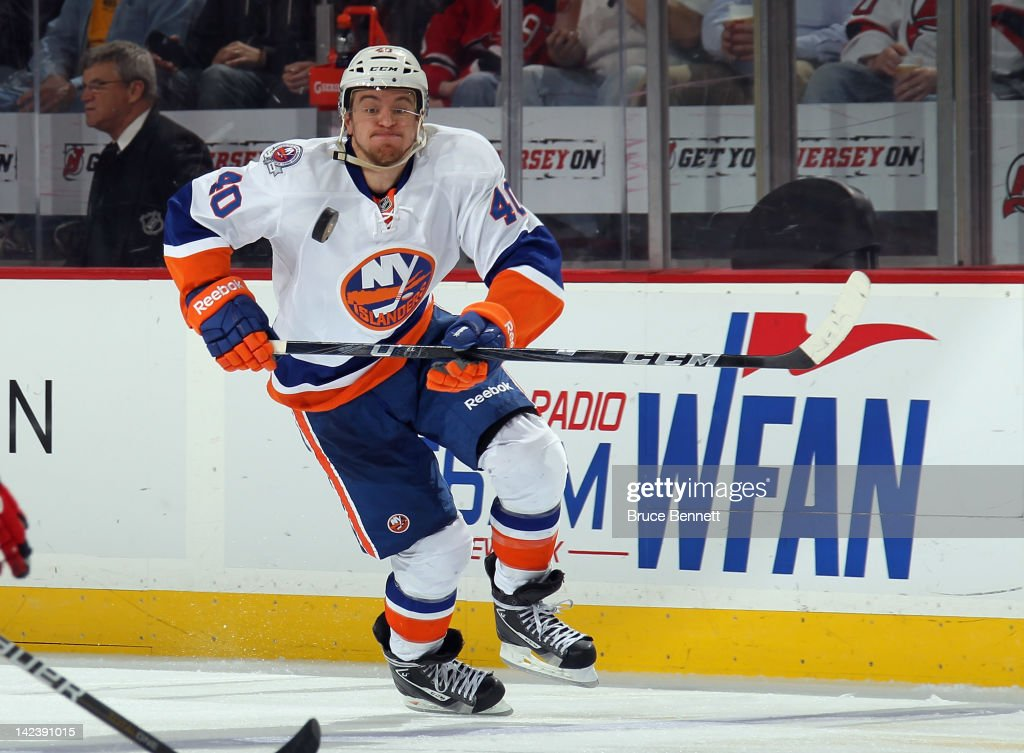 <a gi-track='captionPersonalityLinkClicked' href=/galleries/search?phrase=Michael+Grabner&family=editorial&specificpeople=537955 ng-click='$event.stopPropagation()'>Michael Grabner</a> #40 of the New York Islanders keeps his eye on the puck as he skates against the New Jersey Devils at the Prudential Center on April 3, 2012 in Newark, New Jersey. The Devils defeated the Islanders 3-1.