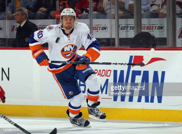 Michael Grabner of the New York Islanders keeps his eye on the puck as he skates against the New Jersey Devils at the Prudential Center on April 3...