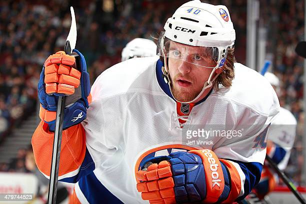 Michael Grabner of the New York Islanders looks on from the bench during their NHL game against the Vancouver Canucks at Rogers Arena March 10 2014...