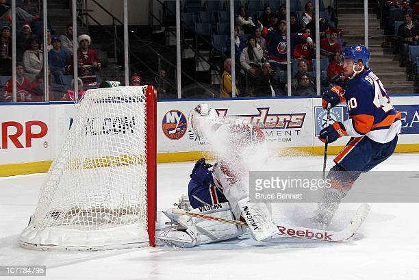 Michael Grabner of the New York Islanders scores a second period goal against Carey Price of the Montreal Canadiens at the Nassau Coliseum on...