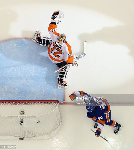 Michael Grabner of the New York Islanders scores at 142 of the first period against Rob Zepp of the Philadelphia Flyers at the Nassau Veterans...
