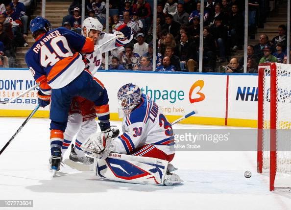 Michael Grabner of the New York Islanders scores his third period goal getting it past goaltender Henrik Lundqvist of the New York Rangers on...