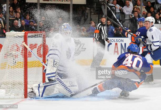 Michael Grabner of the New York Islanders sprays snow on Jonas Gustavsson of the Toronto Maple Leafs during NHL game action January 23 2012 at Air...