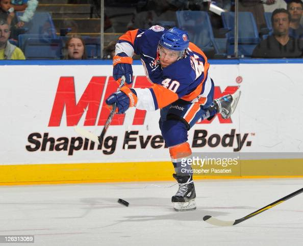 Michael Grabner of the New York Islanders takes a shot on goal during the second period of a preseason game against the New Jersey Devils at Nassau...