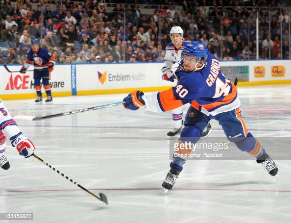 Michael Grabner of the New York Islanders takes a shot on goal during the second period against the New York Rangers at Nassau Coliseum on November...