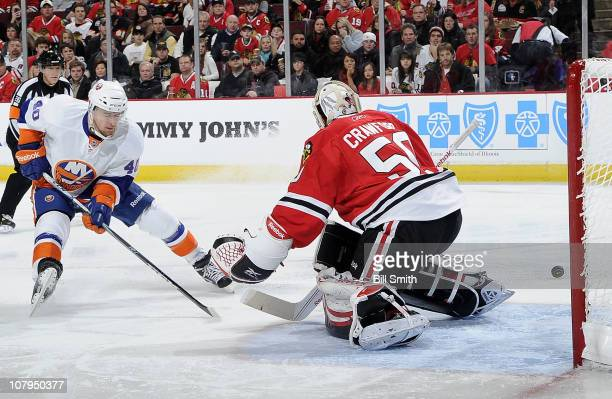 Michael Grabner of the New York Islanders tries to score on goalie Corey Crawford of the Chicago Blackhawks on January 9 2011 at the United Center in...